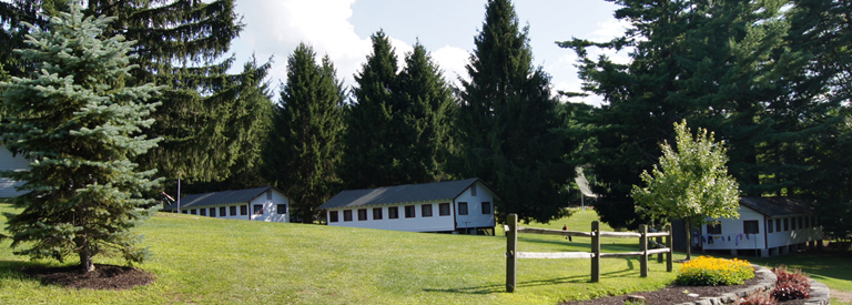 summer camp field flagpole cabins